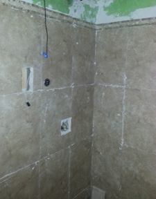 Tiling plumbed wall