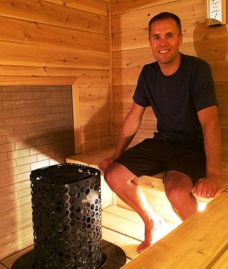 Photo of Tom H sitting in his sauna enjoying his Himalaya-heater