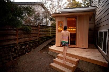 Gwen-walking-into-sauna