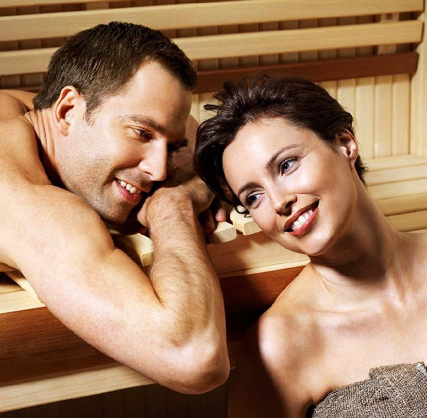 two people sitting in sauna