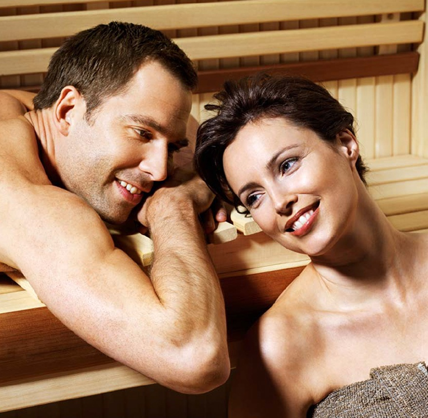 two people sitting in sauna