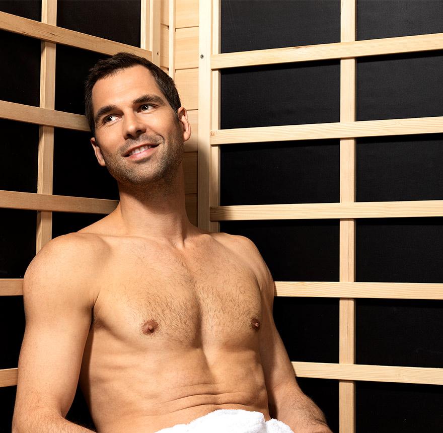 man sitting in sauna