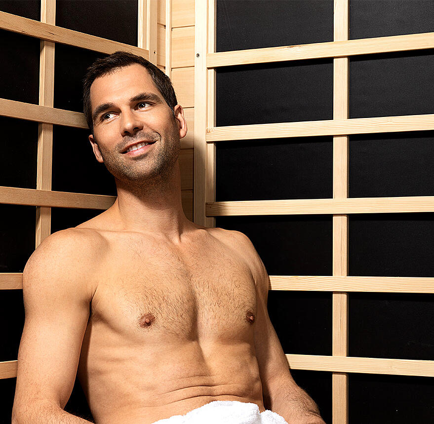 man sitting in sauna